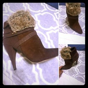 Boots with the fur brown red  or brick  color